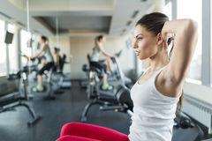 Young woman in the gym Stock Images