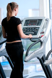 Young woman at the gym. Run on a machine Stock Image