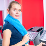 Young woman at the gym run on on a machine Stock Photo