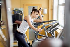 Young woman in the gym. Young woman training in the gym Royalty Free Stock Images