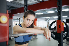 Young woman at the gym using fitness equipment. Stock Images