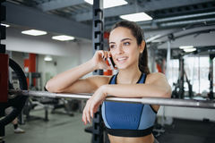 Young woman at the gym using fitness equipment. Royalty Free Stock Images