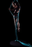 Young woman gymnast with blue gymnastic aerial silks Royalty Free Stock Photo
