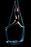 Young woman gymnast with blue gymnastic aerial silks Stock Photos