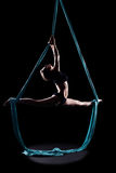 Young woman gymnast with blue gymnastic aerial silks Stock Photo