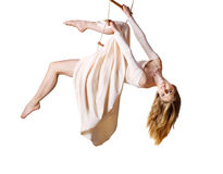 Young woman gymnast  on rope-ladder Royalty Free Stock Photography