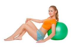 Young woman with gymnastic ball Stock Image