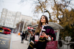 Young woman hailing a taxi on the street in the city Stock Photography
