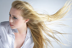 Young Woman With Hair Blowing Behind royalty free stock photography