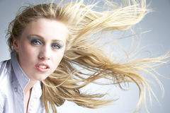 Young Woman With Hair Blowing Behind royalty free stock photos