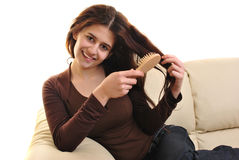 Young woman with a hair brush in her hand Stock Image