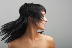 Young woman with hair flying Stock Images