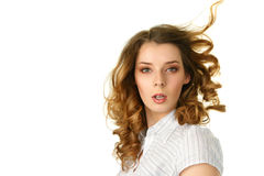 Young woman with hair flying under. Wind Stock Image