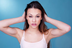 Young Woman with Hair in Hands Stock Images