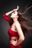 Young woman with hair lightly fluttering Royalty Free Stock Photos