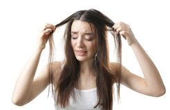 Young woman with hair loss problem. On white background Stock Photos