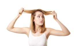 Young woman with hair loss problem. On white background Stock Photo
