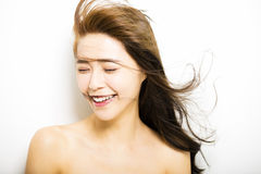 Young Woman  with hair motion on white Stock Image