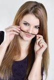 Young woman with hair moustaches Stock Photos