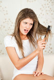 Young woman with hair problem Stock Image
