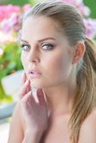 Young Woman with Hair Pulled Back and Hand on Chin Royalty Free Stock Photos