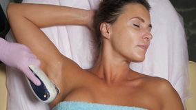 Hair removal from underarms stock video footage