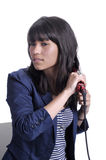 Young woman with hair straightener. Royalty Free Stock Image