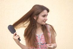 Young woman with hairbrush Stock Image