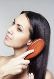 Young woman with hairbrush Stock Photos