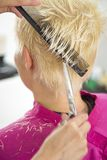 Young woman at hairdresser Royalty Free Stock Photography