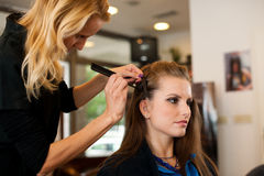 Young woman in hairdresser saloon having a treatment and haircut Royalty Free Stock Photography