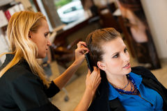 Young woman in hairdresser saloon having a treatment and haircut Royalty Free Stock Photo