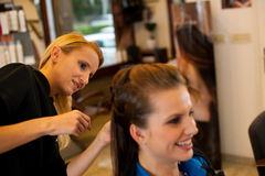 Young woman in hairdresser saloon having a treatment and haircut Royalty Free Stock Photos
