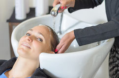 Young woman at the hairdressing salon Royalty Free Stock Photo
