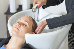 Young woman at the hairdressing salon Stock Images