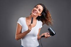 Young woman with a hairdryer Royalty Free Stock Photography