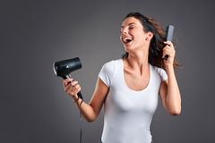 Young woman with hairdryer Stock Photos