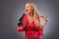Young woman with a hairdryer Stock Photo