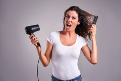 Young woman with a hairdryer Stock Image