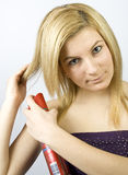 Young woman with hairspray Stock Photos