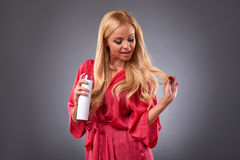 Young woman with a hairspray Stock Photo