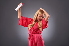 Young woman with a hairspray Stock Image