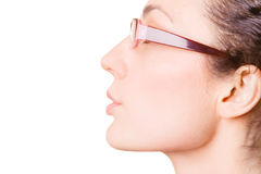 Young woman half face. Young woman in glasses half face on white background Stock Photography