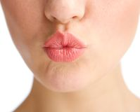 Young woman half face kissing lips Stock Image
