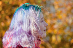 Young woman half face with streaks hair Stock Photo