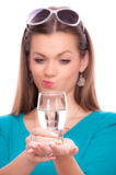 Young woman with half full glass of water Stock Photography