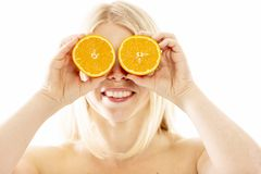 Young woman with halves of oranges, close-up royalty free stock photo