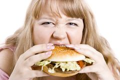 The young woman and hamburger Royalty Free Stock Image