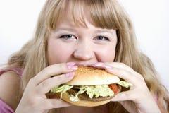 The young woman and hamburger Royalty Free Stock Photo