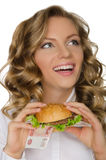 Young woman with hamburger from RUR looking away Royalty Free Stock Photo